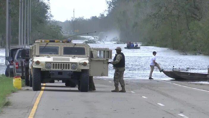 """Search crews """"trying to save lives"""" in Louisiana after hurricane"""